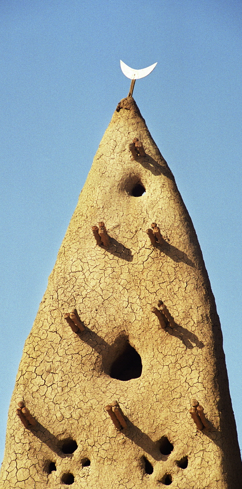 Mali: Minaret of a mud mosque. Each year the mosque is given a new layer of clay to replace what the rains have washed away. Dieter Telemans / Panos