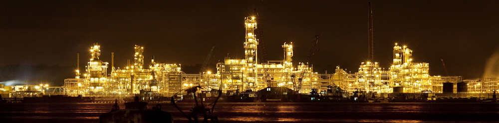 Niger Delta: Chevron LPG installations lit up at night. Oil pollution in the Delta is causing tremendous problems for the local community. Petterik Wiggers / Panos