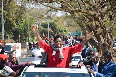 Hakainde Hichilema waves to the crowd on his release from prison in August. (Xinhua/David Kashiki)