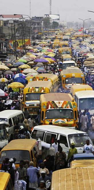 Buses and crowds of people in Oshodi market, Lagos. Jacob Silberberg / Panos