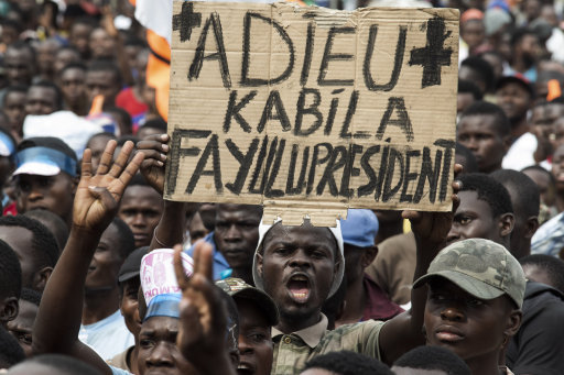 Supporters gather for the cancelled Fayulu campaign rally in Kinshasa on 19 December. Pic: Stefan Kleinowitz/Zuma Press/PA Images