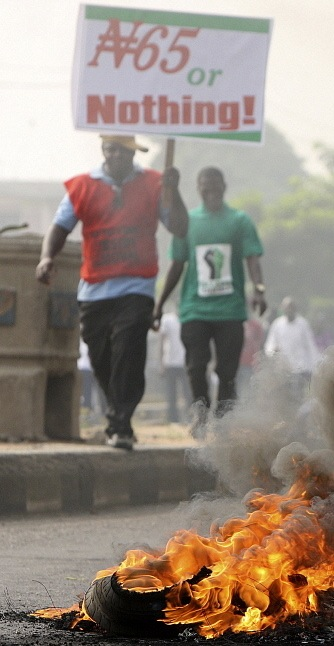 Lagos: Demonstrators holding a placard which reads 'N(aira) 65 or nothing' burn tyres and protest in Lagos against the government's decision to remove a popular fuel subsidy.
