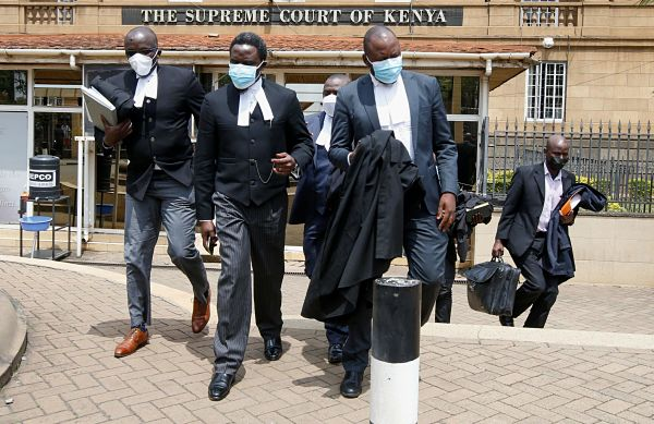 Lawyers on break during the ruling of the BBI case, Nairobi, 20 August 2021. Pic: Monicah Mwangi / Reuters / Alamy