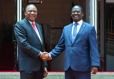 Historic handshake: Uhuru Kenyatta (L) shakes hands with Raila Odinga in Nairobi on 9 March 2018. Pic: Seth Emmanuel/Xinhua News Agency/PA Images