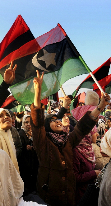 Woman waving the flag of Free Libya in Benghazi