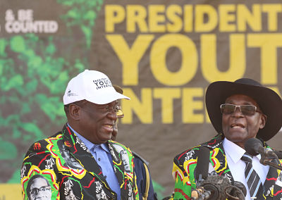 Mnangagwa and Mugabe attend a youth interface rally in Gweru in September this year.  Stringer/Xinhua News Agency/PA Images