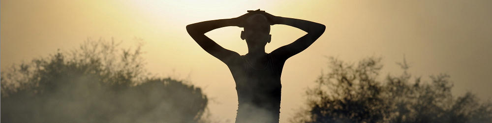 A silhouette of a person in a village just outside Juba. Photographer: Sven Torfinn