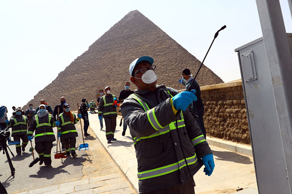 A staff member disinfects near the Pyramids in Giza, 25 March 2020. Pic: Ahmed Gomaa/Xinhua News Agency/PA Images