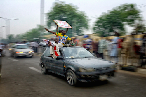 KANO: Jubilant youths celebrate the victory of Muhammadu Buhari. Samuel Aranda / Panos