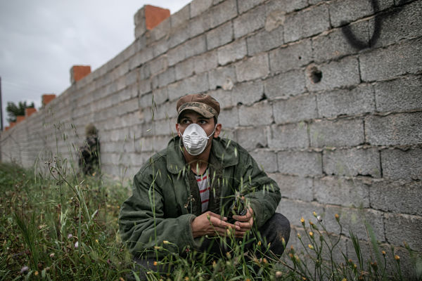 A GNA fighter wearing face mask in Tripoli, 25 March 2020. Pic: Pan Xiaojing/Xinhua News Agency/PA Images