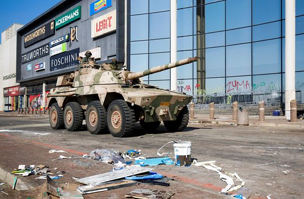 A tank patrols after several days of looting following the imprisonment of Jacob Zuma. Pic: Rogan Ward / Reuters / Alamy