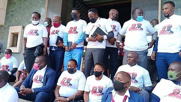 MPs protest against the detention Allan Ssewanyana and Muhammad Ssegirinya. Pic: @HEBobiwine