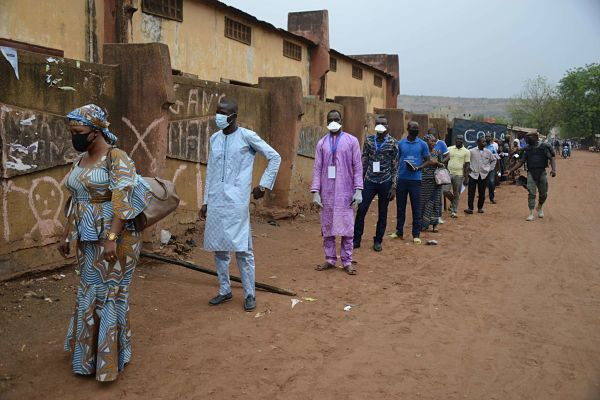 Voters keep a distance in a queue as they wait to cast their ballots at a polling station in Bamako on March 29, 2020. Pic: Habib Kouyate/Xinhua News Agency/PA Images