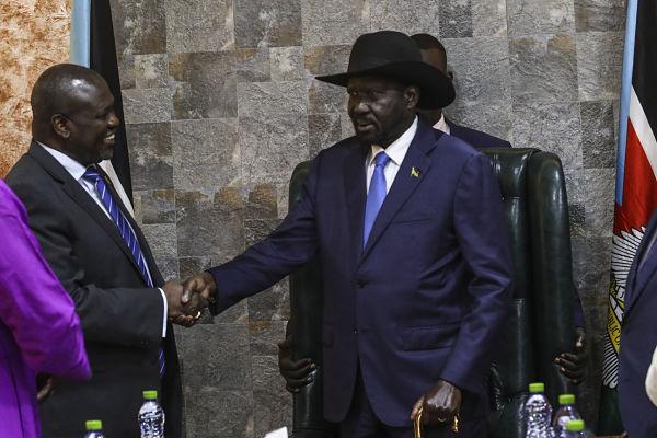 Riek and Salva shake hands, Juba, September 2018. UN Photo/Isaac Billy