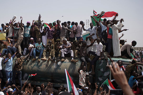 Khartoum 12 April 2019: Sudanese soldiers and demonstrators sit on top military vehicles, outside the Defence Ministry a day after the arrest of Omer el Beshir. Pic: Ala Kheir/DPA/PA Images
