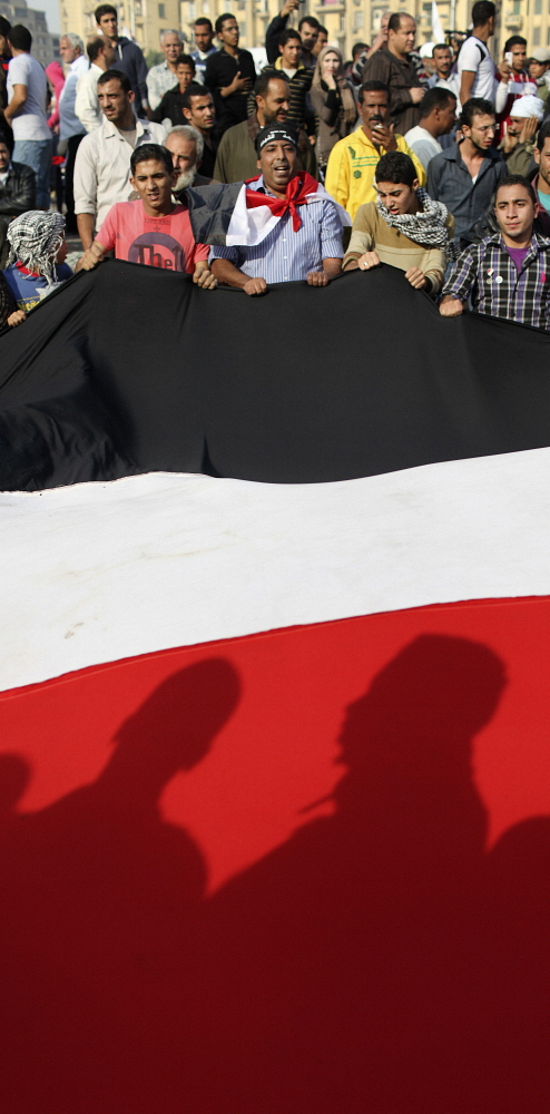 EGYPT: Protesters unfurl a huge Egyptian flag during a demonstration in Tahrir Square. Adam Hinton / Panos