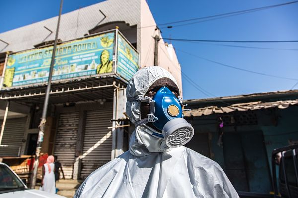 A bulldozer and a disinfection unit were mobilised on, 22 March, to clean and partially destroy the Tilene market, in the Medina district of Dakar. Pic: Sadak Souici / Le Pictorium/Maxppp/PA Images