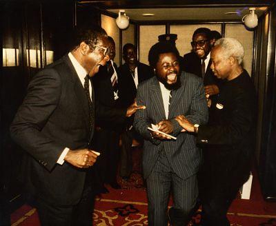 Wilf Mbanga (with notebook) sharing a joke with Robert Mugabe and Julius Nyerere in 1984