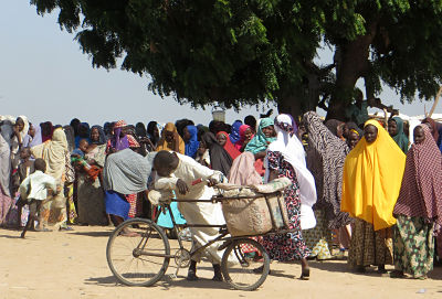 Long queues at a food distribution point in the Muna Garage refugee camp in Maidugrui. The camp is occupied by Nigerians who have fled from Boko Haram. Photo: Sam Olukoya/dpa