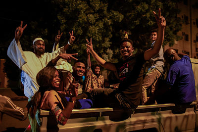 Celebrations outside Sudanese army headquarters after Lt Gen. Awad Mohamed Ahmed Ibn Auf stepped down. Pic: Ala Kheir/DPA/PA Images