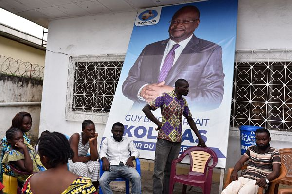 Supporters of Guy-Brice Parfait Kolélas gather at the UDH-Yuki office in Brazzaville, 22 March 22. Pic: Olivia Acland / REUTERS / Alamy