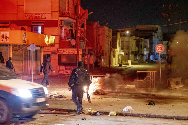 Protestors clash with police in Tunis on the third night of clashes since January 14. Pic: Fauque Nicolas/Images de Tunisie/ABACA/ABACA/PA Images