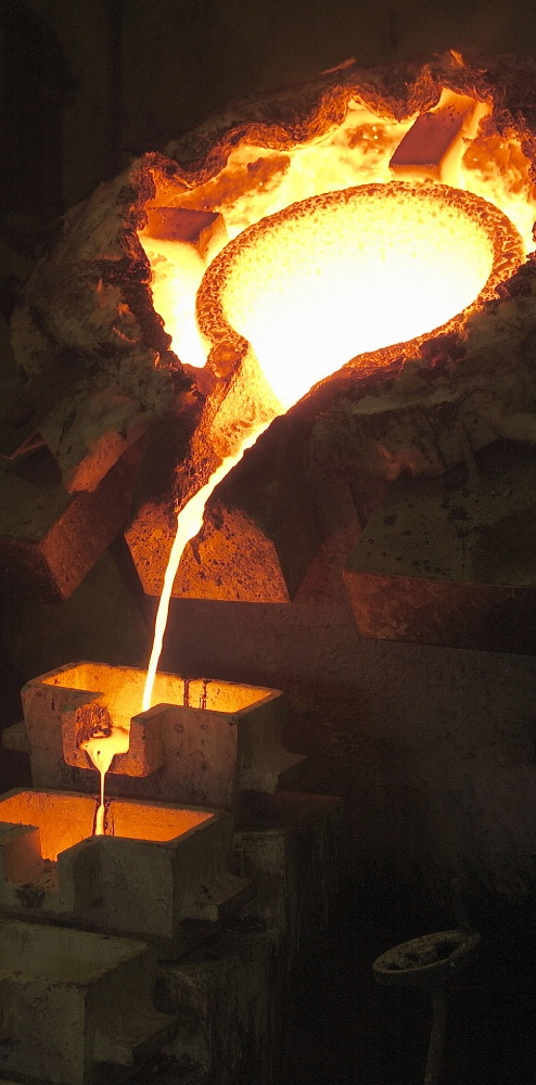 GHANA Obuasi: Gold pouring into moulds that form gold bars. Jacob Silberberg / Panos