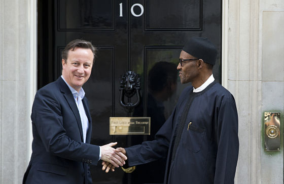 Britain's Prime Minister David Cameron shakes hands with Nigerian President-elect Muhammadu Buhari on the doorstep of 10 Downing Street (AP Photo/Alastair Grant)