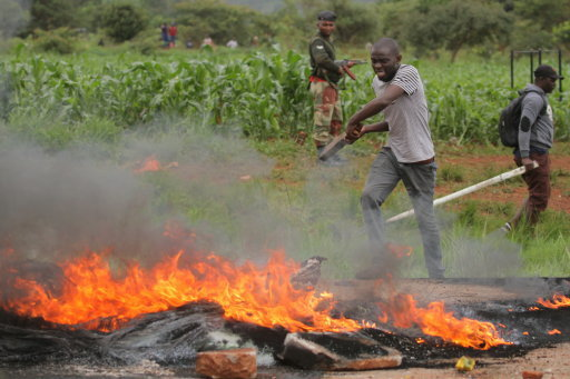 Protesters burn tyres on the highway from Harare to Bulawayo. Pic: Shaun Jusa/Xinhua News Agency/PA Images