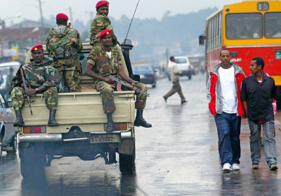 Members of the Ethiopian army patrol the streets of Addis Ababa after clashes with protesters. (AP Photo/Karel Prinsloo, 10/06/05)