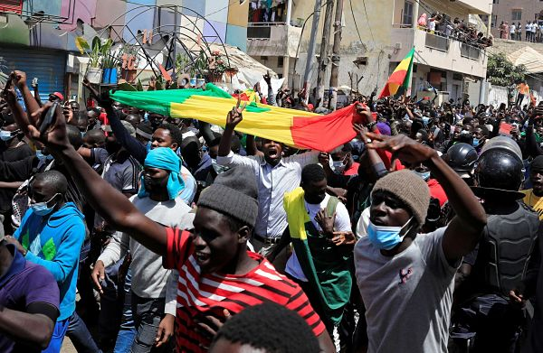 Supporters of Ousmane Sonko attend a demonstration in front of the court in Dakar, 8 March 2021. Pic: Zohra Bensemra / Reuters / Alamy