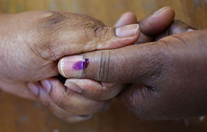 Year of elections: a woman has her thumb nail marked with indelible ink to prove that she has voted. Pic: Schalk van Zuydam / AP/Press Association Images