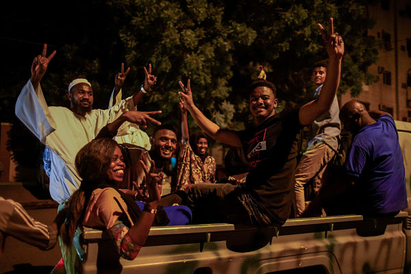 April 2019. People celebrate outside Army HQ in Khartoum. Pic: Ala Kheir/DPA/PA Images