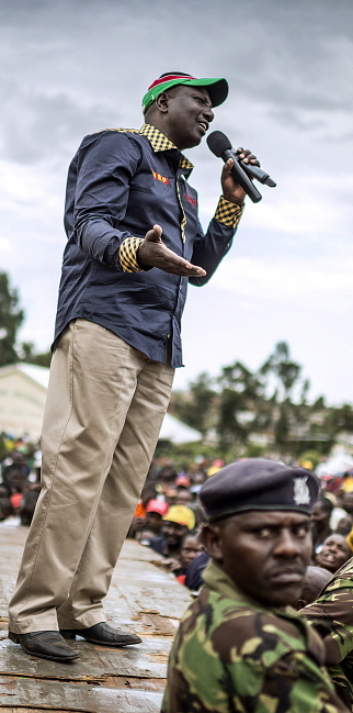 KENYA Kitale: William Ruto, surrounded by his security guards, speaks to a crowd of supporters during a campaign rally for the 2013 general elections. Sven Torfin / Panos