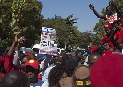 People protest over the closure of The Post newspaper in Lusaka. (AP Photo/Moses Mwape)