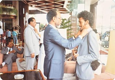 Hassan el Turabi adjusts the tie of Amin Hassan Omer, now in charge of Darfur. This picture has been doing the rounds on Sudanese social media with the caption: 'He taught them everything, even to tie their ties'.