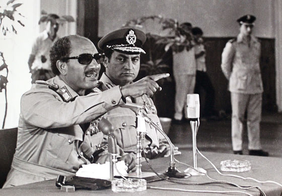In this undated photo taken in 1979, Egypt's President Anwar Sadat, left, makes remarks as Vice-President Hosni Mubarak, center, looks on in Cairo, Egypt. (AP Photo/Farouk Ibrahim)