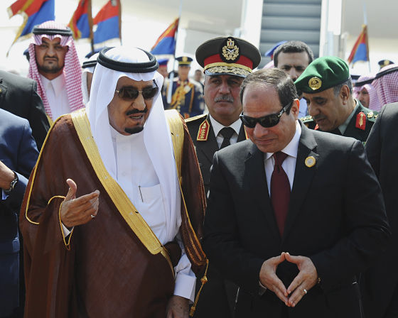 Egyptian President Abdel Fattah el-Sisi, right, talks with Saudi King Salman after the king arrived in Sharm el-Sheikh, Egypt, Saturday, March 28, 2015. El-Sisi later made the remarks at the opening session of an Arab summit held in Egypt's Red Sea resort of Sharm el-Sheikh. (AP Photo/MENA) (AP Photo/MENA)